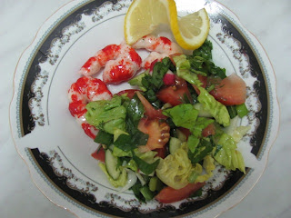 Shrimps and salad on plate