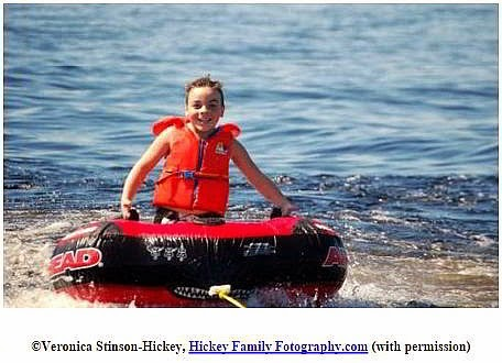 A young boy in a water tube.