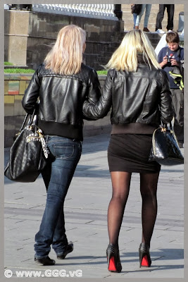 Girls in black leather jacket on the street
