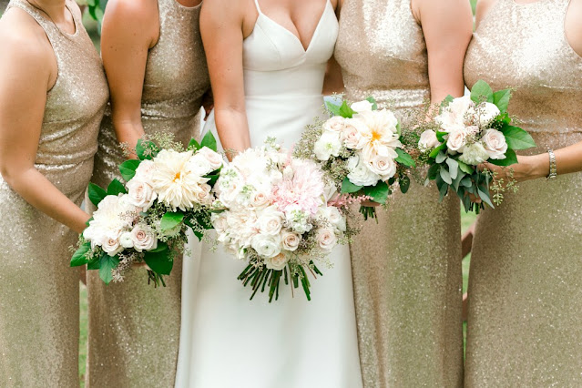 bridemaids with gold sparkly dresses