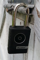 Master Lock 4401DLH Outdoor Bluetooth padlock in place