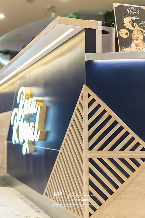 Sunway pyramid rasa royal kiosk with corporate identity element of triangle wood strips