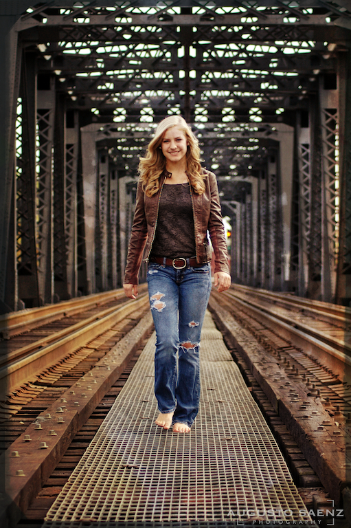 Senior Picture of girl walking barefoot by rail tracks Columbus, OH