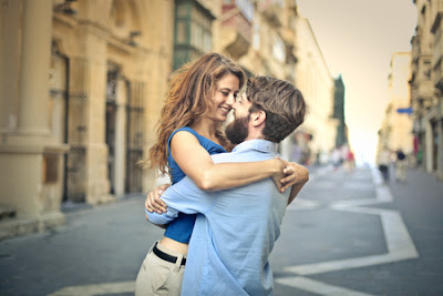man lifting girl in a hug as they smile