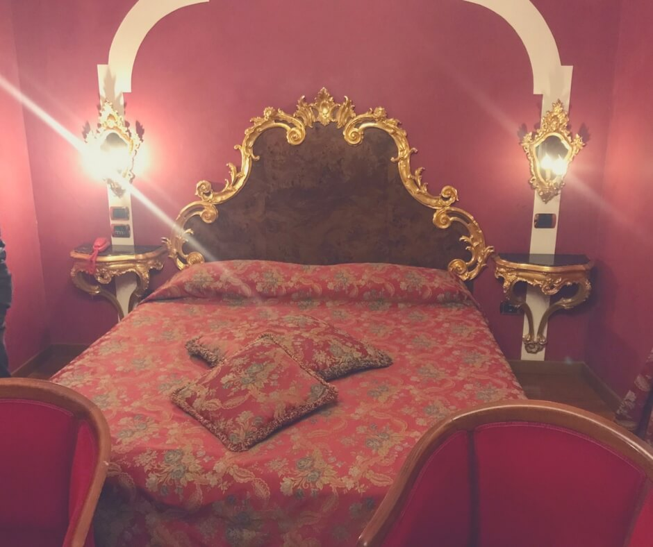 Venice hotel room bed - very red