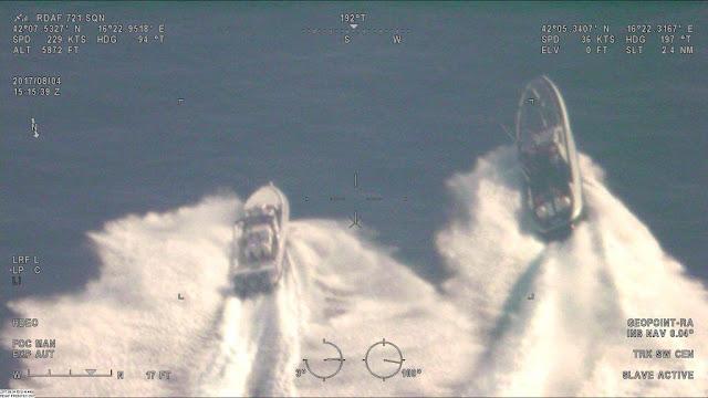 police speedboat chasing traffickers speedboat