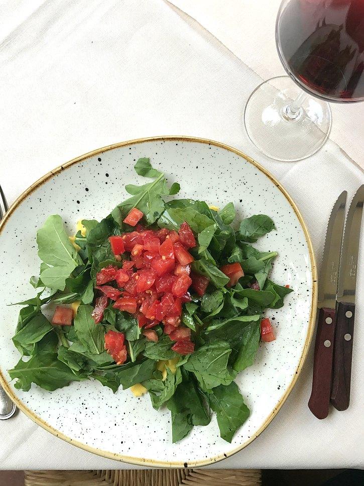 Potato ravioli topped with spinach and tomatoes at La Cantinetta di Rignana.