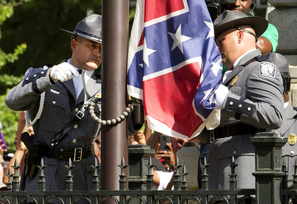 70 Of The Most Touching Photos Taken In 2015 - The confederate flag is permanently removed from the South Carolina State House.