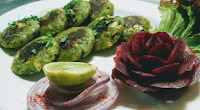 Vegan Patty Hara bhara i kebab in garnished plate