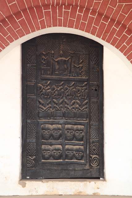 a carved wooden door of the old palace