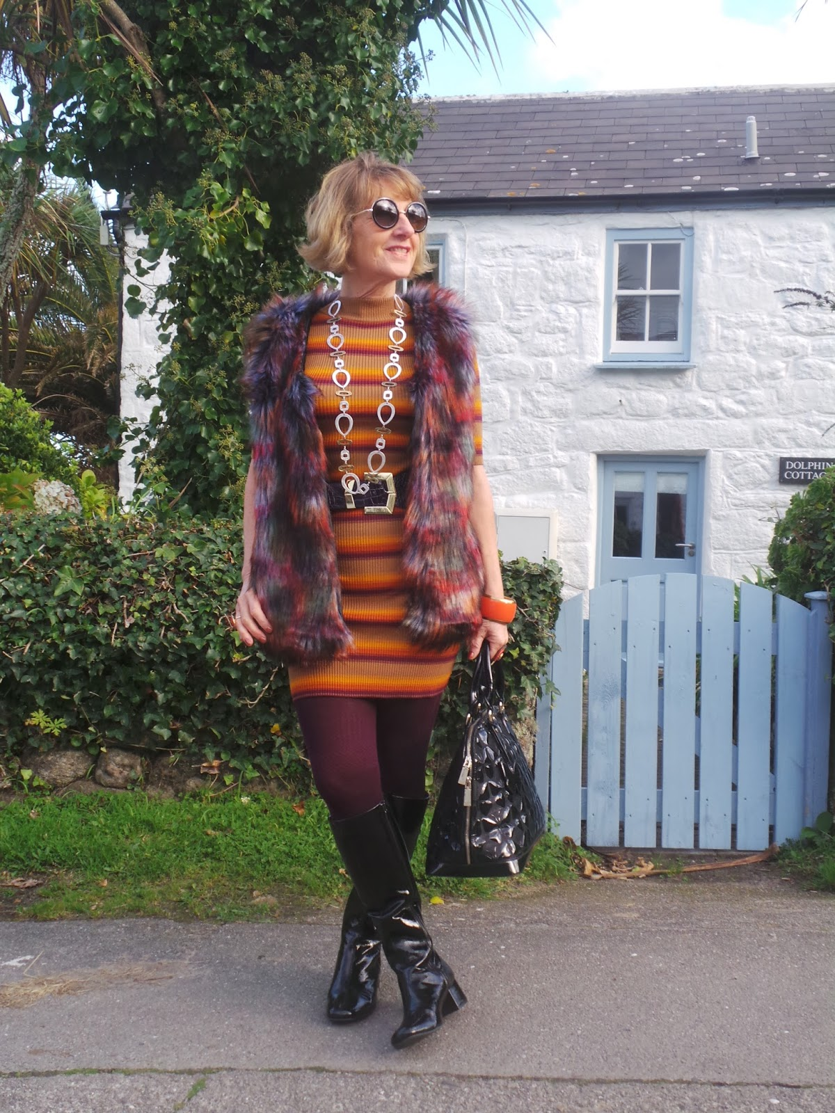 Image showing over 50s blogger Anna parkes from Annas Island Style in 60s influenced oufit with black patent boots