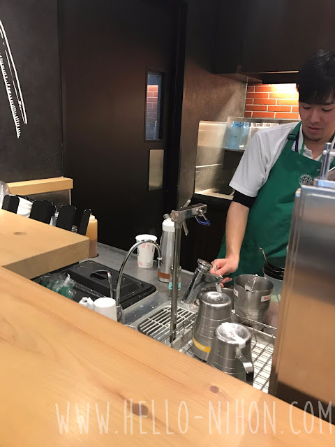 Starbucks worker making my drink