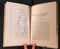 An open book with a map on the left page and text on the right.