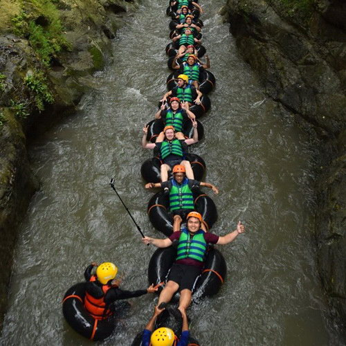 Tinuku Travel Sedayu karst tubing down and immerse selves into Surobayan river cracks in karst region Bantul