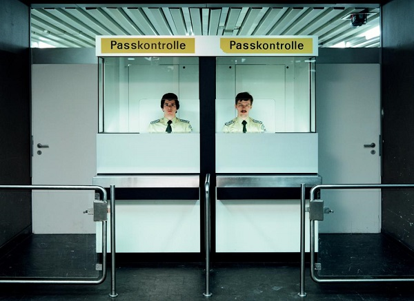 Andreas Gursky - Desk Attendants, Passport Control, 1982 (2007)