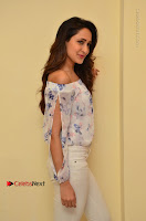 Actress Pragya Jaiswal Latest Pos in White Denim Jeans at Nakshatram Movie Teaser Launch  0034.JPG