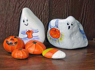 ghosts, pumpkins, candy corn, painted rocks, Halloween, rock painting