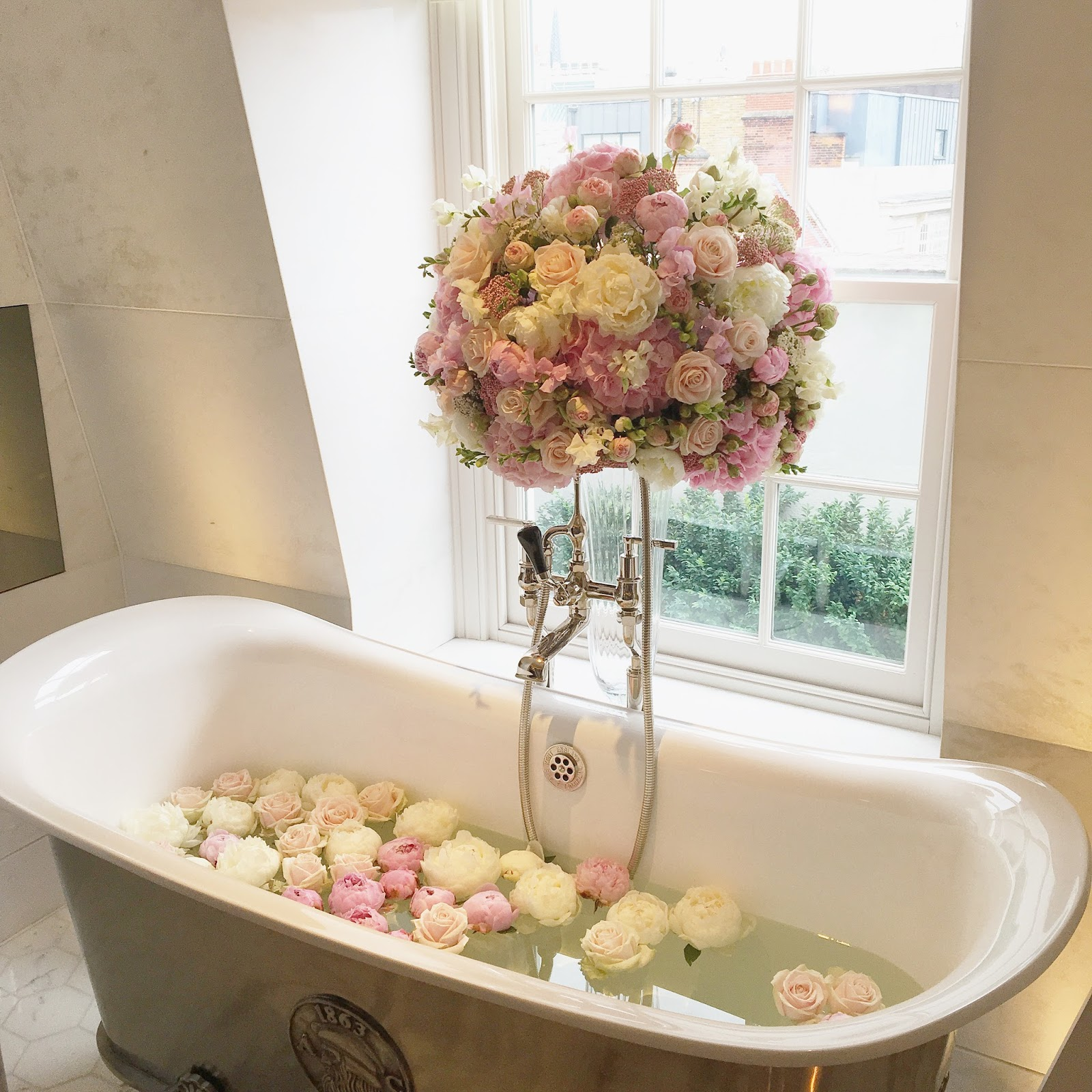 bath tub filled with flowers