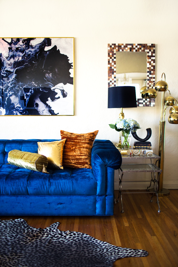 Color Forecast Pantone Spring 2014 Color Report Living Room with Dazzling Blue Velvet Couch Hide Area Rug Hardwood Floors