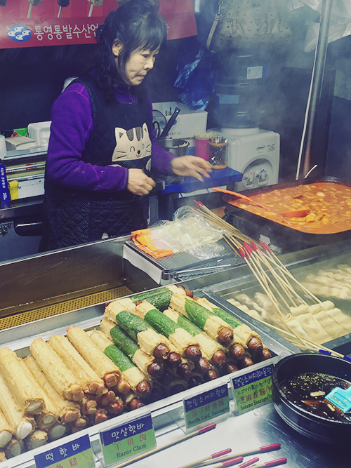 The area surrounding our hotel was filled with stalls selling breads, hotteok, sweet potatoes, and sausages wrapped in all these things. Choui-ro, Jung-gu, Seoul, South Korea. 29 December 2015.
