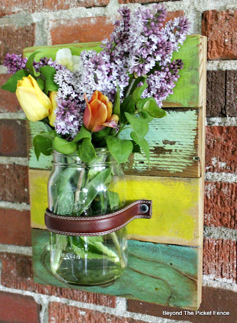 mason jar, vase, pallet wood, scrap wood, salvaged, wall vase, lilacs, leather belt, http://bec4-beyondthepicketfence.blogspot.com/2016/05/mason-jar-wall-vase.html