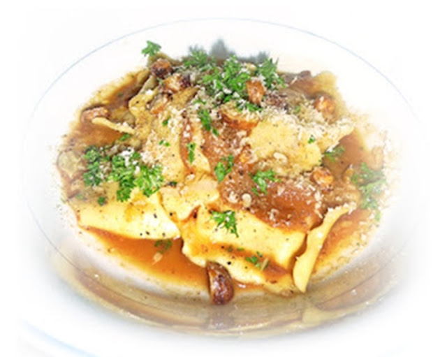 ravioli in lamb and cobnut sauce