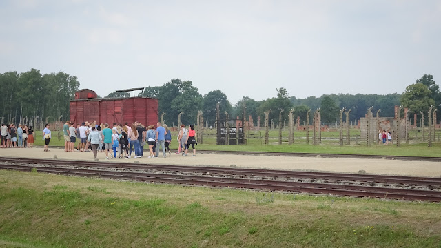 Tourists look like prisoners of Auschwitz
