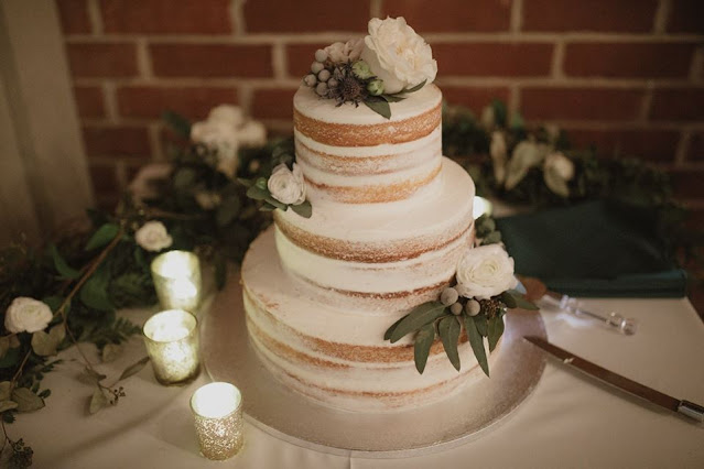 wedding cake with dark foliage