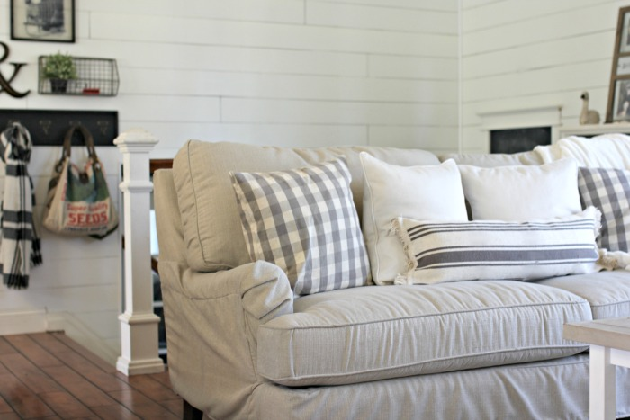 DIY Shiplap, Birch Lane Montgomery slipcovered sofa and DIY Ikea lumbar pillow - www.goldenboysandme.com