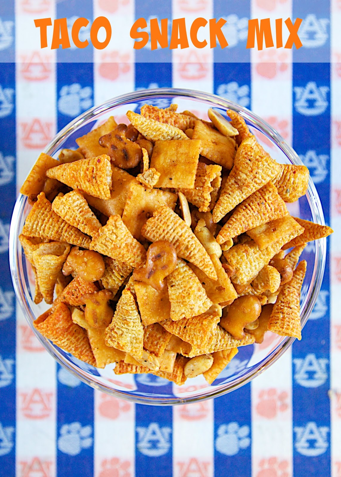 Taco Snack Mix - so addictive!! Bugles, pretzels, cheez-its, peanuts tossed in taco seasoning and oil. Great for snacking on during parties and tailgates!! Everyone RAVES about this yummy snack mix recipe!
