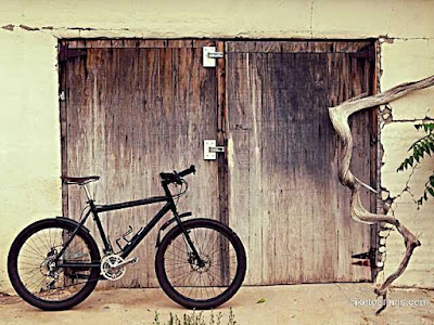Picture of mountain bike and barn doors at New Mexico