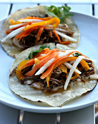 Slow Cooker Cuban Pork for Tacos or Sandwiches from Elly Says Opa featured on SlowCookerFromScratch