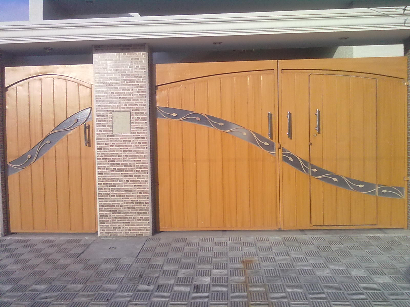 New gate design house in pakistan modern design for Wooden main gate design for home