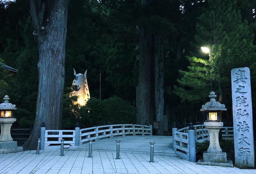 A dimly illuminated entrance of Okunoin Cemetery Koyasan Japan