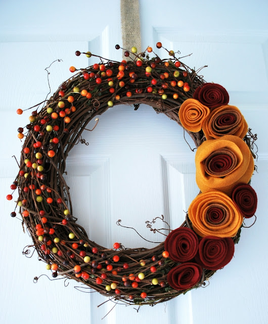 http://craftingmom.com/fall-wreath-with-felt-rosettes/