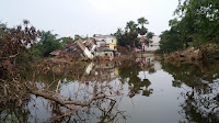 Buildings all around the village of Pratappur were swamped after flood defenses failed (Photo Credit: Aditi Roy Ghatak) Click to Enlarge.