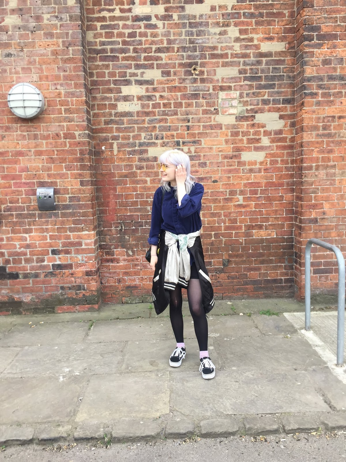 silver haired girl wearing vans, vintage navy shirt and souvenir jacket