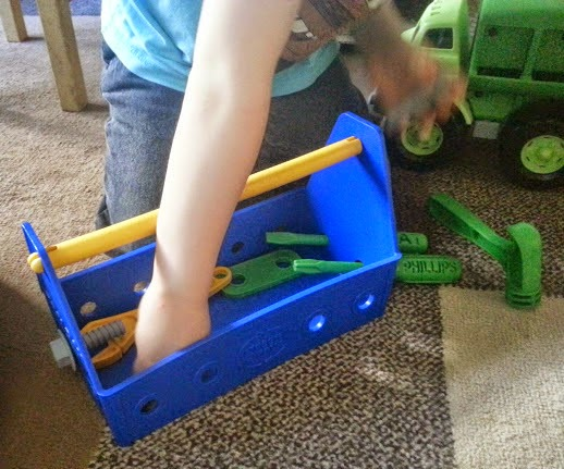 Children demonstrating fine motor skills using recycled plastic play tools