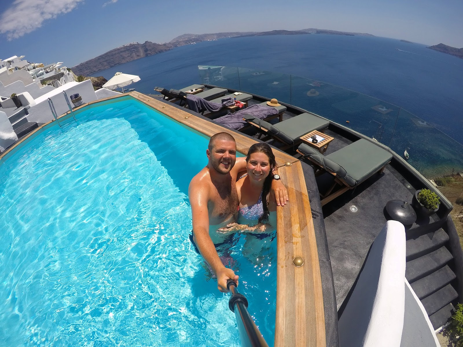 Couple in pool at Nostos Apartments Oia Santorini