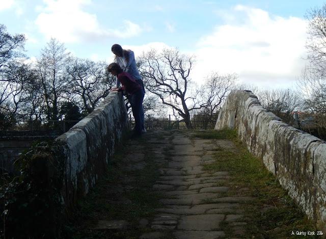 Playing-Pooh-Sticks-on-Beggar's-Bridge-Glaisdale-North-Yorkshire-Moors