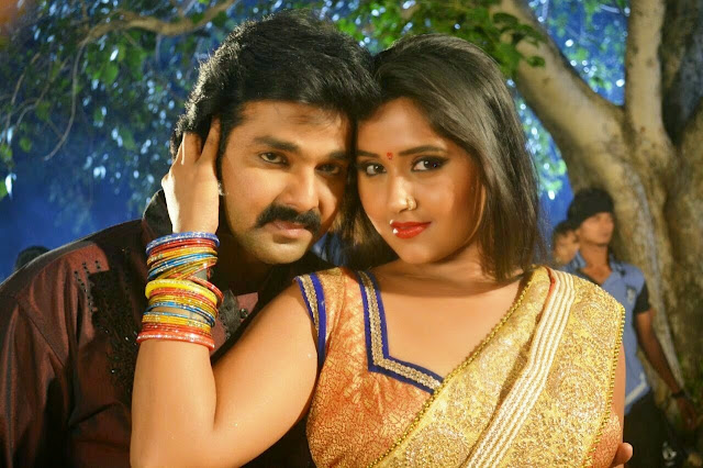Pawan Singh and with actress Kajal Raghwani