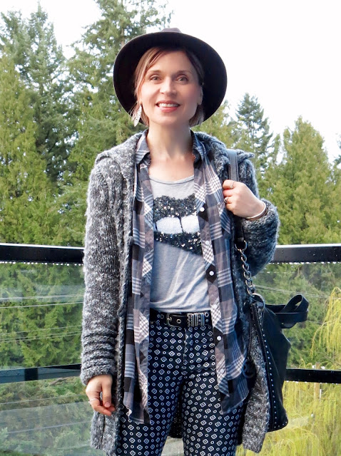 sequinned t-shirt, plaid shirt, sweater-coat, printed pants, and felt fedora