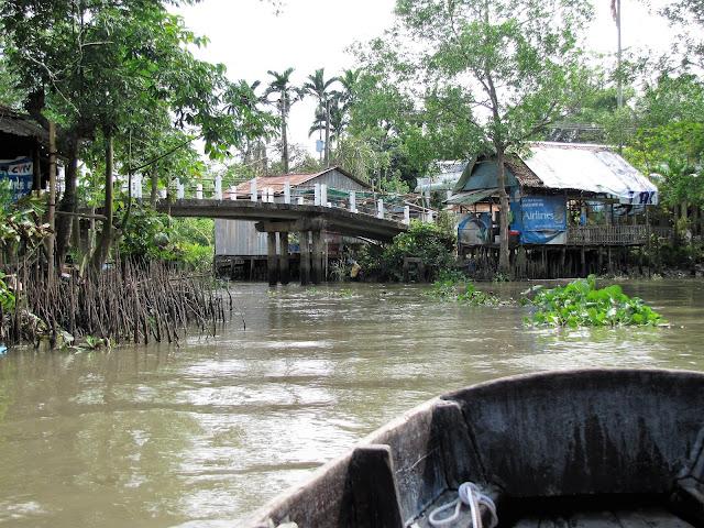 village bridge canal mekong delta vietnam
