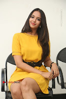 Actress Poojitha Stills in Yellow Short Dress at Darshakudu Movie Teaser Launch .COM 0196.JPG