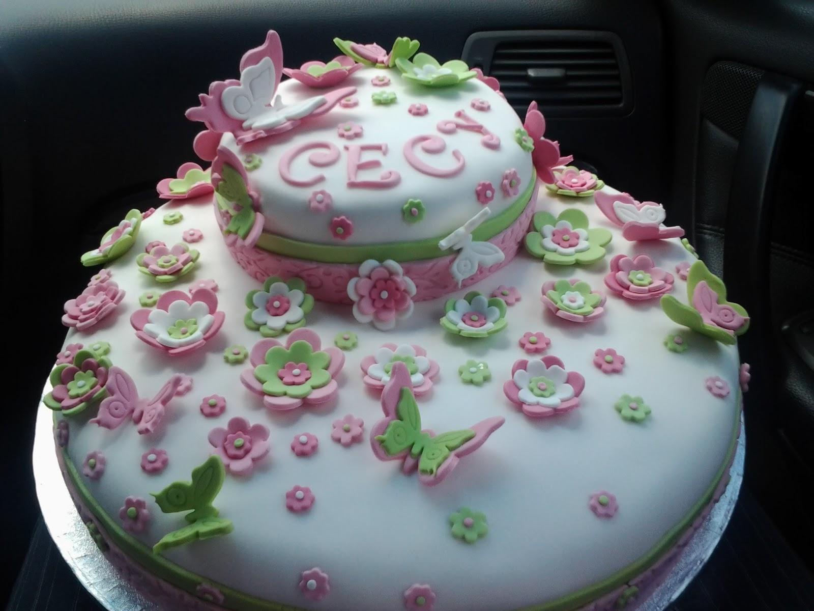Amato Vaniglia e Caffè: la torta con fiori e farfallein trasporto. IY88