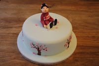 Cake with model of Japanese lady in kimono made of sugarpaste