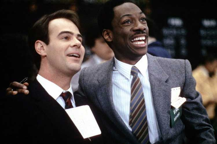 Eddie Murphy and Dan Akroyd celebrate their success in Trading Places.