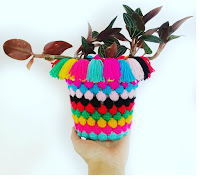 http://setfreemygypsysoul.blogspot.co.uk/2016/06/Free-fast-crochet-pattern-popcorn-bobble-stitch-plant-pot-cozy-sock.html
