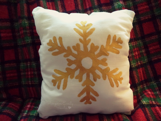 Gold snowflake pillow