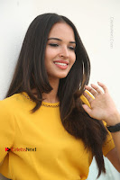 Actress Poojitha Stills in Yellow Short Dress at Darshakudu Movie Teaser Launch .COM 0174.JPG